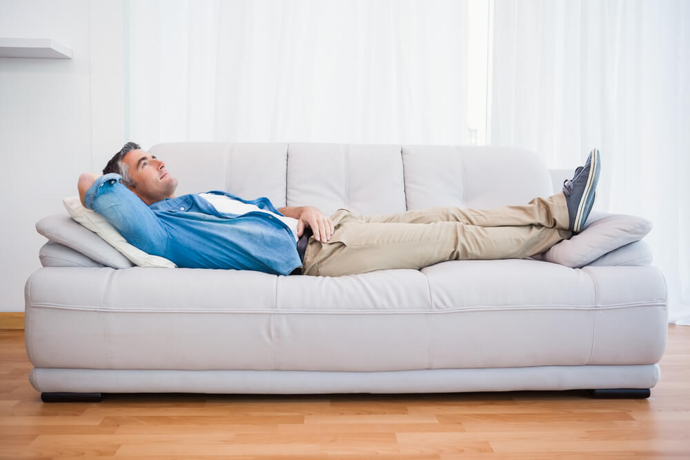 Howard Air - Man Lying On Couch Enjoying Cold A/C
