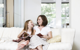 Howard Air - Mother & Daughter Enjoying Cool Air Conditioning in Home