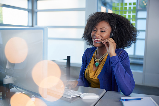 Portrait of a smiling customer service representative with an afro